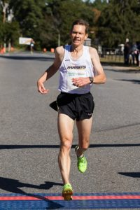 Nat Larson of Amherst crosses the finish line with first place finish and a time of 16:36 in the Applefest 5K. Photo/Jeff Slovin