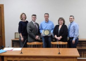(l to r) Kim Foster, assistant town administrator; John Coderre, town administrator; William Pantazis, chair, Board of Selectmen; June Hubbard-Ward, finance director; and Jason Little, town accountant.