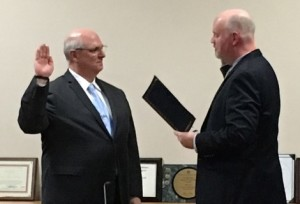 Shortly after his appointment by selectmen, new Fire Chief David L. Parenti (left) is sworn in by Town Clerk Andrew Dowd. Photo/Keith Regan