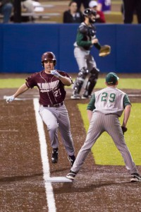 Algonquin shortstop Ryan Solomon runs to first as he singles in the sixth inning.