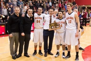 Marlborough basketball captains and coaches with their Central Mass. Division 2 championship trophy.