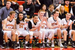 Marlborough basketball players watch with anticipation as the final seconds tick down before their victory over Concord-Carlisle.
