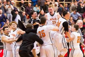 Marlborough basketball players celebrate winning the Central Mass. Division 2 championship.