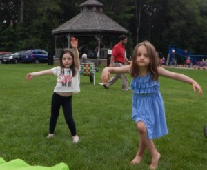 Cousins Julia Marini and Hailie Rose Concalves of Shrewsbury dance to the music.