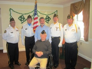 Members of the American Legion's Vincent F. Picard Post 234 flank Warren DeVault. (From l to r) Ed Bombard, Jerry Bourque, Roger Langevin, Rick Nieber and Larry Beatty.
