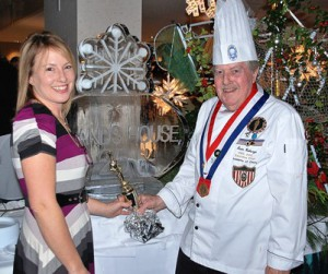 Nanette Roberge and her award-winning father Chef Leon Roberge pose with his sculpture, adorning his shrimp and raw bar.