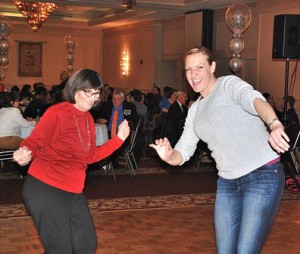 Ann Addeo and Brooke Markowitz dance with music provided by deejay Matt Ruffing.