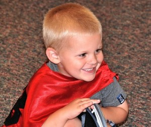 Colby Spencer, 4, enjoys hearing a story read by the instructor.
