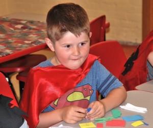 Cameron Citro, 5, creates a refrigerator magnet with his super powers.