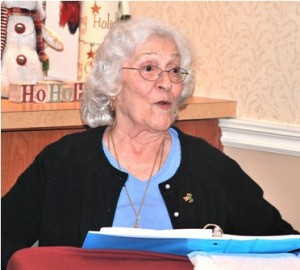 Ann Falco reads an autobiographical essay she wrote to guests attending a book publication party at Whitney Place Assisted Living Residences at Northborough. Photo/Ed Karvoski Jr.