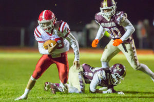 St. John's Dan Byers breaks free from a tackle and heads towards the end zone.