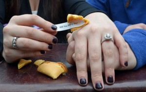 Morgan Foley opens a fortune cookie to find a marriage proposal from her boyfriend Mike Brown.