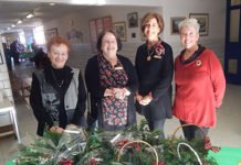 (l to r) Francesca Bombara, Ann Webster, Suzanne McCance and Kathleen Devericks pose for a photo at the Northborough Garden Club's annual Holiday Enchantment event held Dec. 1 at the Marguerite E. Peaslee Elementary School. Photo/Melanie Petrucci
