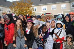 Students from the Lincoln Street School arrive for the Halloween parade. Photo/Nance Ebert