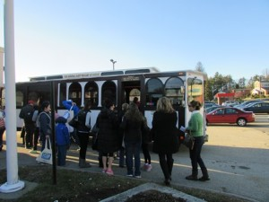 Residents board the Holiday Trolley.