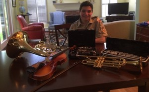 James Miotto of Northborough with some of the instruments he has collected as part of his Eagle Scout project. (Photo/submitted)