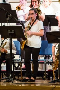 Kelly Slovin, who received an individual award for Outstanding Musicianship, plays the alto sax during the Central District Junior Jazz Festival.