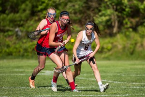 Algonquin's (#8) and North Middlesex' Kimmie Zuccaro (#19) vie for the ball.