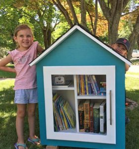 Emma and Jack Gavalis posing with their Little Free Library Photos/submitted