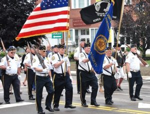 The color guard of American Legion Vincent F. Picard Post 234 march on Main Street.