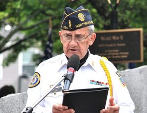 Gerard Bourque of American Legion Vincent F. Picard Post 234 reads names on the honor roll.