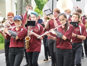 The Algonquin Regional High School Marching Band provides patriotic music on the parade route.