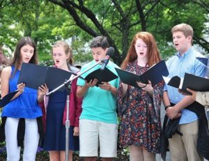 "Members of the Algonquin Regional High School Chamber Choir sing ""To Those Who Serve."""