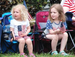 The Hamond sisters – Alexis, 2, and Felicia, 5, watch the parade wearing star-spangled outfits. The girls are the great-nieces of PFC First Class Neil R. Ellsworth, a Northborough resident who was killed in Vietnam.