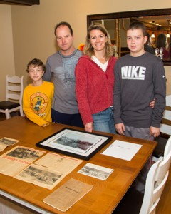 (l to r) Aiden, Mark, Amy and Cameron Johnson pose in front of their collection of mastodon artifacts. (Photo/Jeff Slovin)