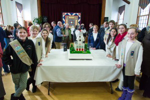 "Northborough Girl Scouts pose with the ""Cake Boss"" cake."
