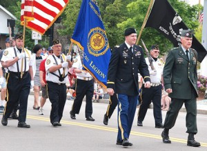 The American Legion Vincent F. Picard Post 234 Color Guard leads the parade.