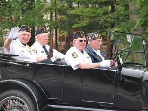 Riding a 1926 Model T Ford are American Legion Vincent F. Picard Post 234 members (l to r) Larry Schafer, Joseph McCarthy, Al Graefing and Arthur Butt.
