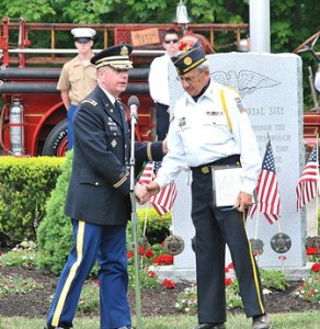 State Rep. Harold Naughton Jr. is introduced by Parade Chair Gerard Bourque at the Veterans Memorial in the Howard Street Cemetery.