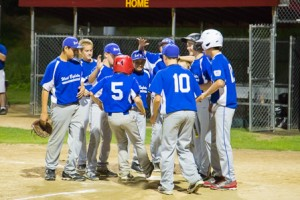 West Boylston's Adam Fuller is greeted by teammates after his home run.