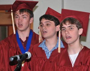 "(l to r) Brendan Forde, Jack Tzianabos and Evan Ribaudo sing ""The Star-Spangled Banner."""