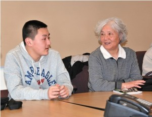 Henry Liu and Ning Yin participate in a conversation circle at Algonquin Regional High School. Photo/Ed Karvoski Jr.