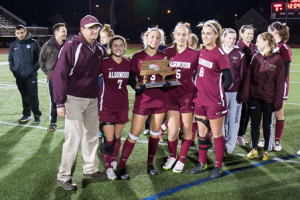 Algonquin coach Scott Taggart and captains (from left) Kendall Sweeney, Meagan Stassi, Caroline Leonard and Kate Hostage pose with their trophy.