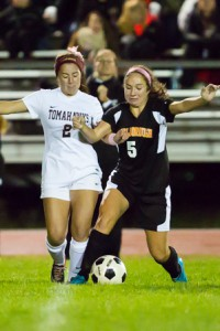 Algonquin's Caroline McAndrews (#2) and Marlborough's Casey Sibole (#5) vie for the ball