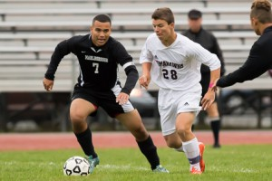 Marlborough's Paulo Silva (#7) and Algonquin's Sebastian Royo (#28) vie for the ball