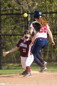 Algonquin's first baseman Vikki Elliott stretches for the ball as Westborough's Kaylie Doherty reaches base safely