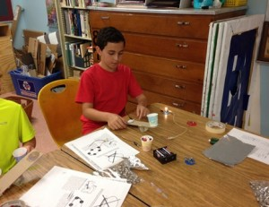 Students in St. Bernadette's summer program conduct experiments in science and technology.