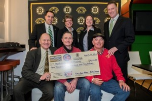 (Back row, l to r) Mike Dargin, Boston Bruins ICE School manager, Ellie Cheever, chair of the Mick Cheever Grow Hockey Development Program, Mass Hockey President Keri-Anne Allan, Bob Sweeney, Boston Bruins Alumni President, (front row, l to r) Tom Songin, former Boston Bruins player, and Mark Macaulay and Zach MacDonald of the Starhawks Youth Hockey program. (Photo/submitted)