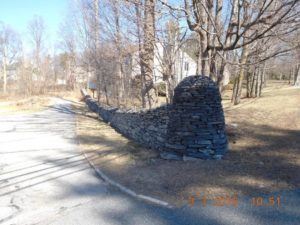 One of the remaining stone walls marking the original boundary of Daniel Wesson's property on Main Street. (Photo/Norm Corbin)