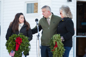 Gold Star mothers Tracy Vaillancourt and Leslie Arsenault receive wreaths from Adam Costello during a Wreaths Across America ceremony at the Vincent F. Picard American Legion Post 234.