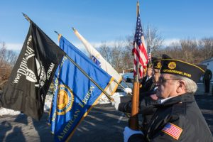 The color guard from the Vincent F. Picard American Legion Post 234 presents the colors.