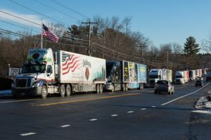 The convoy of tractor trailers hailing wreaths to Arlington National Cemetery lines up along Rt. 20 in Northborough.