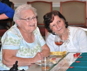 Barbara Mereschuk and Toni Terenzi keep their eyes on the money wheel while attending Casino Night during National Assisted Living Week, observed September 8 through 14 at Whitney Place Assisted Living Residences at Northborough. Photo/Ed Karvoski Jr.