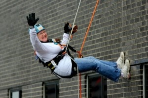 Sara MacLean waves as she rappels down the side of the Hyatt Regency in Boston. (Photo/submitted)