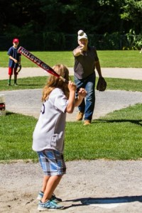 Retired MLB pitcher Paul Mitchell pitches to Sara Sullivan during the home run derby.