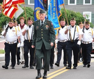 Bruce Goldsmith and the Color Guard of the American Legion Vincent F. Picard Post 234 lead the parade. Goldsmith was named the Legionnaire of the Year.